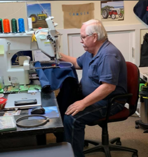The team at Kelso Custom Covers embroidering a logo onto a bag